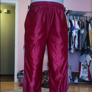 red pants with buttons on the side. (never worn)